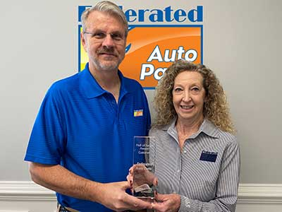 Herb Godschalk, president of Fisher Auto Parts and Sue Godschalk, president of Federated Auto Parts Accept GCommerce Award
